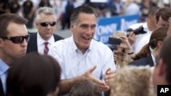 Republican presidential candidate and former Massachusetts Gov. Mitt Romney shakes hands during a campaign event in Hobbs, New Mexico, Aug. 23, 2012.
