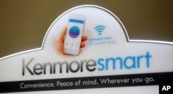 A Kenmore Elite Smart sign rests on top of the Kenmore Elite Smart French Door Refrigerator at a Sears store, July 20, 2017, in West Jordan, Utah.