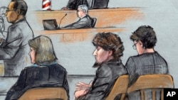 In this courtroom sketch, Assistant U.S. Attorney Aloke Chakravarty, left, is depicted addressing the jury as defendant Dzhokhar Tsarnaev, second from right, sits between his defense attorneys during closing arguments in Tsarnaev's federal death penalty t
