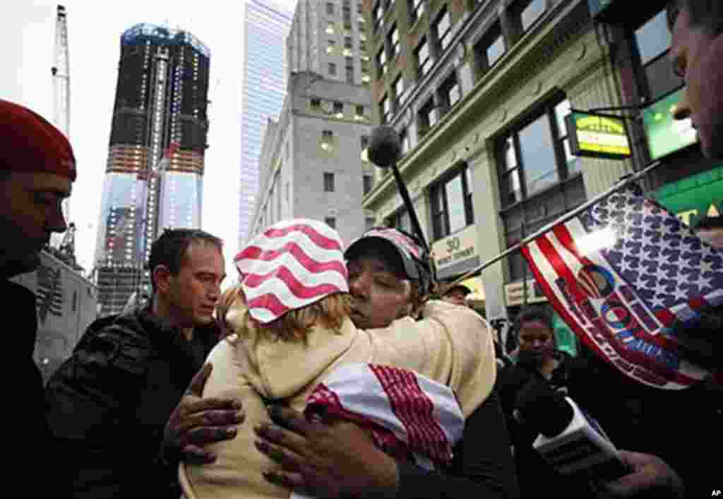 Dionne Layne, facing camera, hugs Mary Power as they celebrate the news of the death of Osama bin Laden, New York City, May 2, 2011; At left is the rising tower, 1 World Trade Center, also known as the Freedom Tower (AP)
