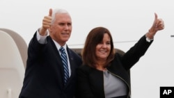 U.S. Vice President Mike Pence and his wife Karen give a thumbs-up as they board Air Force Two at the Yokota U.S. Air Force Base in Fussa, outside Tokyo, Japan, Nov. 13, 2018.