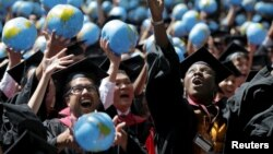 FILE - Graduates celebrate after receiving degrees from the John F. Kennedy School of Government during the 364th commencement exercises at Harvard University, Cambridge, Massachusetts, May 28, 2015.