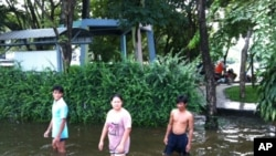 People Wade in Flooded Northwest Bangkok Neighborhood