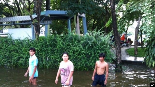 People Wade in Flooded Northwest Bangkok Neighborhood