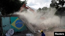 The house of Carlos Augusto and Sandra Regina (not pictured) who have lived in Vila Autodromo slum for 20 years with their children, is demolished after the family moved to one of the twenty houses built for the residents who refused to leave the community, in Rio de Janeiro, Brazil, August 2, 2016. Picture taken August 2, 2016.