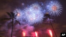 Fireworks from Nagaoka City, Japan, explode over Ford Island to celebrate the 70th anniversary of the end of World War II at Joint Base Pearl Harbor-Hickam, in Honolulul, Aug. 15, 2015.