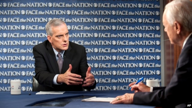 "In this Sunday, Sept. 8, 2013, photo provided by CBS News, White House Chief-of-Staff Denis McDonough speaks during an interview with Bob Schieffer on CBS's ""Face the Nation"" in Washington."