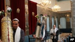 FILE - Syrian Jews celebrate Passover at the al-Firenj Synagogue in downtown Damascus, Syria, April 20, 2008. Artifacts removed from one of the oldest synagogues in the world in the Syrian capital have gone missing after neighborhood officials said they gave them to commanders of a rebel group who never gave them back.