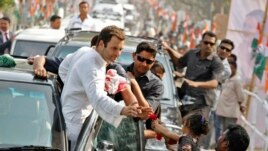 FILE - Rahul Gandhi, India's ruling Congress party vice president, during a road show ahead of the 2014 general elections, Feb. 26, 2014.