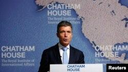 北约秘书长拉斯穆森6月19日在伦敦