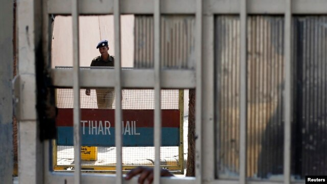 FILE - A policeman walks inside the Tihar Jail in New Delhi.