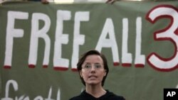 "Sarah Shourd asks for the release of her jailed fiance and friend in front of sign that reads ""Free All 3"" at a vigil in Oakland, California last month"