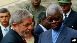 FILE - Mathieu Kerekou, right, who was then the president of Benin, is pictured after a meeting with then-Brazilian President Luiz Inacio Lula da Silva in Cotonou, Benin, Feb. 10, 2006.