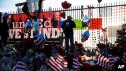 FILE - A makeshift memorial site honors shooting victims in San Bernardino, California, Dec. 7, 2015.