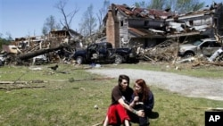Nathaniel Ramey, left, comforts Megan Hurst at her grandmother's house in Askewville, North Carolina., Sunday, April 17, 2011 after a tornado struck Saturday