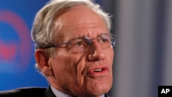 Former Washington Post reporter Bob Woodward speaks during an event sponsored by The Washington Post to commemorate the 40th anniversary of Watergate, June 11, 2012, at the Watergate office building in Washington.