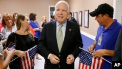 FILE- Arizona Republican Senator John McCain, center, endorses the Trans-Pacific Partnership.