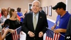 FILE- Arizona Republican Senator John McCain, center, endorses the Trans-Pacific Partnership.