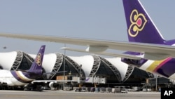 Thai Airways passenger planes park at the ramp of Bangkok's Suvarnabhumi airport.