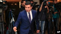 FILE - Selahattin Demirtas, co-leader of the pro-Kurdish Peace and Democracy Party, arrives for a meeting with representatives of minorities living in Turkey at a hotel in central Istanbul ahead of elections, Oct. 28, 2015.