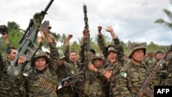 Moro Islamic Liberation Front (MILF) rebels celebrate the signing of the peace agreement during a rally at Camp Darapanan, Sultan Kudarat town, in southern island of Mindanao, March 27, 2014. Some think Islamic State could take advantage of the frustrations of Muslims in the southern region of Mindanao over the federal legislature's failure to ratify a peace deal.