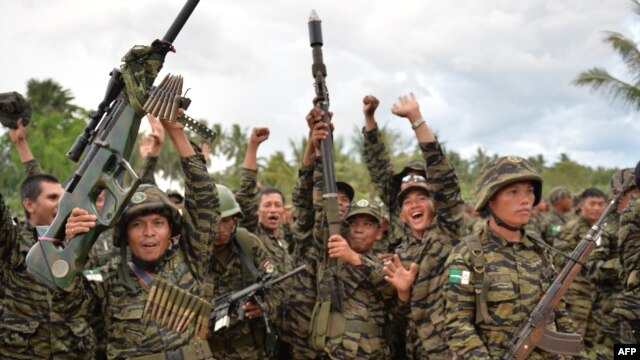 MILF rebels celebrate the signing of the peace agreement during a rally at Camp Darapanan, Sultan Kudarat town, in southern island of Mindanao, March 27, 2014.