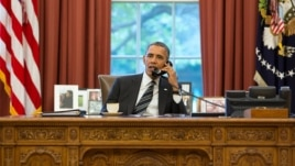 President Barack Obama talks with President Hassan Rouhani of Iran during a phone call in the Oval Office, Sept. 27, 2013.
