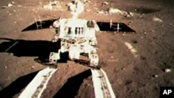 "China's first moon rover, ""Jade Rabbit,"" touches the Moon's surface and leaves deep marks."