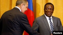 Zimbabwean President Emmerson Mnangagwa greets Russian Foreign Minister Sergey Lavrov before their meeting in Harare, Zimbabwe, March 8, 2018.