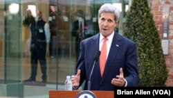 U.S. Secretary of State John Kerry makes a statement about progress in the Iran nuclear talks in Vienna, Austria, July 9, 2015.