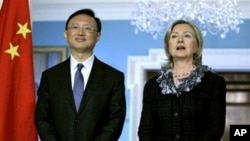 Secretary of State Hillary Rodham Clinton, right, talks during a meeting with Chinese Foreign Minister Yang Jiechi, left, at the State Department, Washington, Jan 5, 2011.