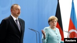 German Chancellor Angela Merkel and President of Azerbaijan Ilham Aliyev attend a news conference following talks at the Chancellery in Berlin, Germany, June 7, 2016. REUTERS/Axel Schmidt