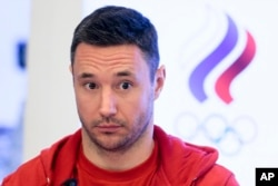 Russia national ice hockey team captain Ilya Kovalchuk listens to a journalist's question during a news conference in Moscow, Russia, Dec. 12, 2017.