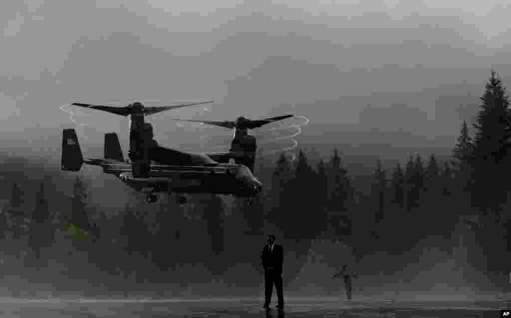 An Osprey aircraft lands in the rain near Schloss Elmau hotel near Garmisch-Partenkirchen, southern Germany, June 8, 2015. The aircraft carries delegation members traveling with U.S. President Barack Obama from the G-7 Summit, to Munich airport.