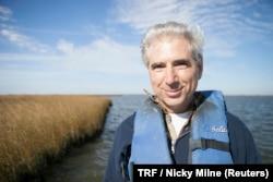 Dr. Alex Kolker, Associate Professor at The Louisiana Universities Marine Consortium, poses for a photo at Cocodrie village, Louisiana, Nov. 11, 2017.