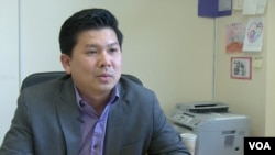 Ok Tolayuth, a Cambodian-American who runs a foster care agency in Lowell.