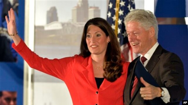 Democratic Senate challenger Alison Lundergan Grimes, left, speaks with former Presidet Bill Clinton at a fundraiser, Galt House Hotel, Louisville, Kentucky, Feb. 25, 2014.
