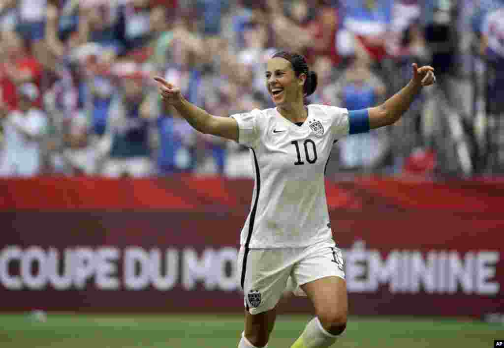 United States' Carli Lloyd celebrates after scoring her third goal against Japan during the first half of the FIFA Women's World Cup soccer championship in Vancouver, British Columbia, July 5, 2015.