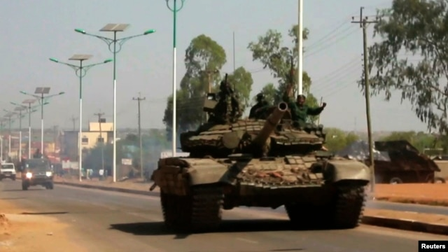 A military tank patrols along one of the main roads in the South Sudanese capital Juba, Dec. 16, 2013.