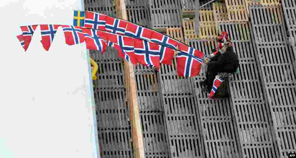 Norwegian supporters follow the Nordic Combined ski jumping competition in the ski stadium of the 2015 FIS Nordic World Ski Championships in Falun, Sweden.