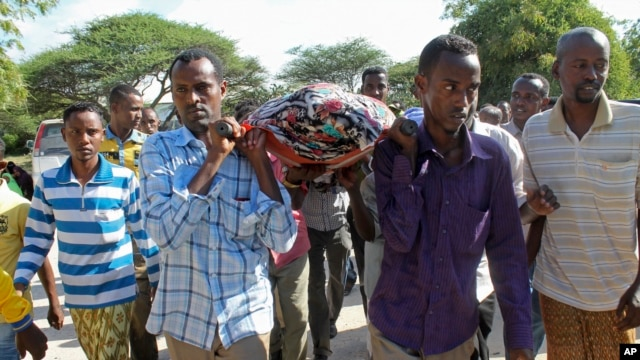Mourners carry the body of Somali journalist Mohamed Mohamud who was killed after being shot six times by gunmen, Oct. 27, 2013.