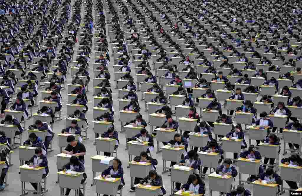 Students take an examination on an open-air playground at a high school in Yichuan, Shaanxi province, China, April 11, 2015.