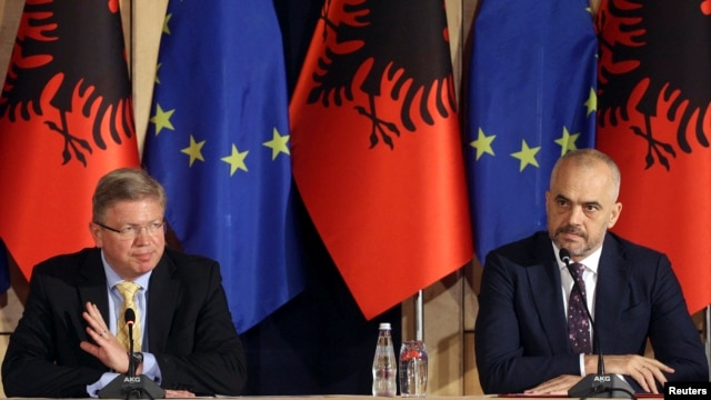 FILE - European Union Enlargement Commissioner Stefan Fuele (L) attends a news conference with Albania's Prime Minister Edi Rama, in Tirana, Albania, June 4, 2014.