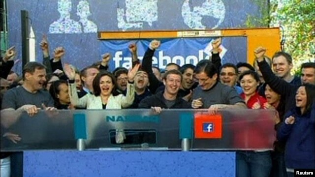 "Facebook Founder and CEO Mark Zuckerberg rings the NASDAQ Stock Market Opening Bell remotely from ""Facebook"" headquarters in Menlo Park, California, May 18, 2012."