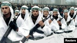 FILE - A Muslim brigade of the Bosnian Army marches in a military parade in Zenica in this 1995 photo. Muslim fighters from Afghanistan, North Africa and the Middle East joined the fighting in Bosnia in the early 1990s.