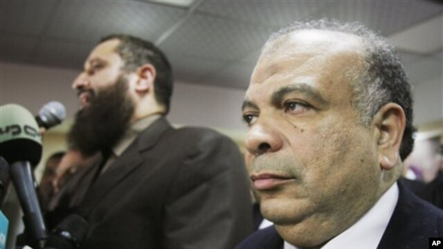 Saad el-Katatni, secretary general for the Muslim Brotherhood's Freedom and Justice Party, right, attends a press conference in Cairo, Egypt, Jan. 16, 2012.