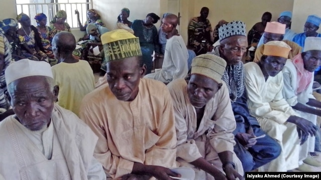 Men and women from Jigawa State wait for interviews to determine if they qualify for surgery to prevent blindness.