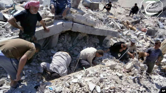 This citizen journalism image provided by Qusair Lens, which has been authenticated based on its contents and other AP reporting, shows Syrian citizens inspecting the rubble of damaged buildings that were damaged from a Syrian forces air strike in the tow