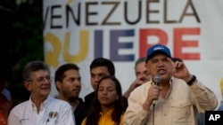 FILE - Opposition spokesman Jesus Torrealba (R) speaks during a campaign rally in Caracas, Venezuela, Nov. 13, 2015.
