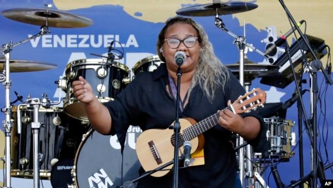 "Reymar Perdomo sings ""I Left,"" during the Venezuela Aid Live concert on the Colombian side of the Tienditas International Bridge near Cucuta, Colombia, on the border with Venezuela, Feb. 22, 2019."